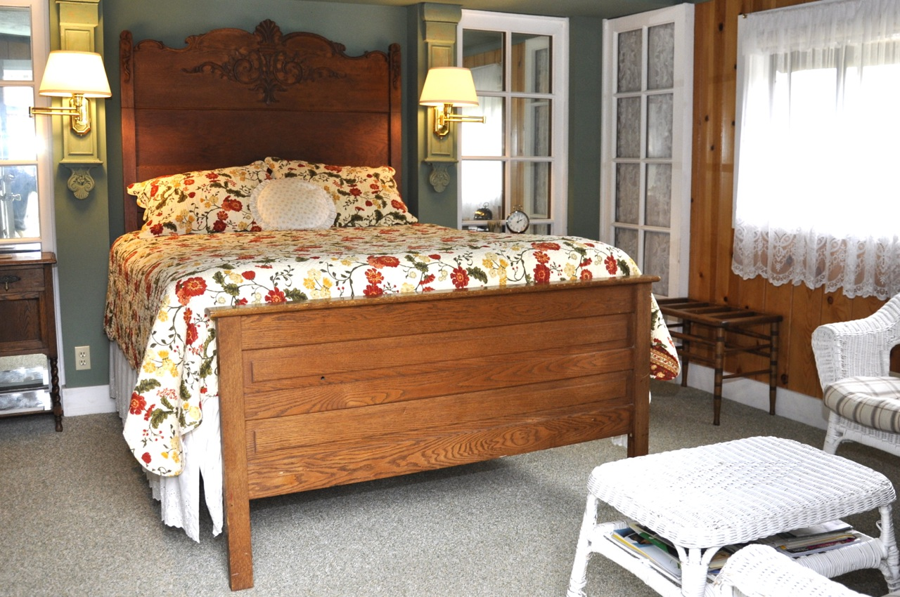 The Garden Gate room bed and the sitting area at Meadow Creek Ranch Inn in Mariposa California near Yosemite National Park